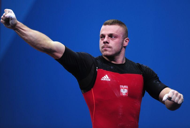 Po dźwignęciu 211 kg w podrzucie Polak wiedział, że ma już medal (fot. Getty Images)