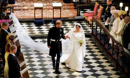 Książę Harry i Meghan Markle opuszczają po ślubie kaplicę św. Jerzego w zamku Windsor. Fot. REUTERS/Owen Humphreys