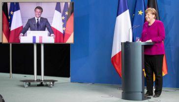 Emmanuel Macron i Angela Merkel (fot. PAP/EPA/ANDREAS GORA / POOL)